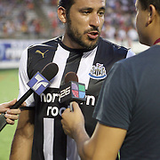 Newcastle United Midfielder Jonas Gutierrez (18) gets interviewed at the half during an International Friendly soccer match between English Premier League team Newcastle United and the Orlando City Lions of the United Soccer League, at the Florida Citrus Bowl on Saturday, July 23, 2011 in Orlando, Florida. Orlando won the match 1-0. (AP Photo/Alex Menendez)