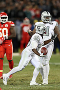 Oakland Raiders running back Jalen Richard (30) complains to officials after running the ball during the 2017 NFL week 7 regular season football game against the against the Kansas City Chiefs, Thursday, Oct. 19, 2017 in Oakland, Calif. The Raiders won the game 31-30. (©Paul Anthony Spinelli)