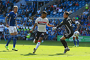 Ashley Fletcher (11) of Middlesbrough takes the ball around Alex Smithies (12) of Cardiff City but is denied a goal by a defender on the line during the EFL Sky Bet Championship match between Cardiff City and Middlesbrough at the Cardiff City Stadium, Cardiff, Wales on 21 September 2019.