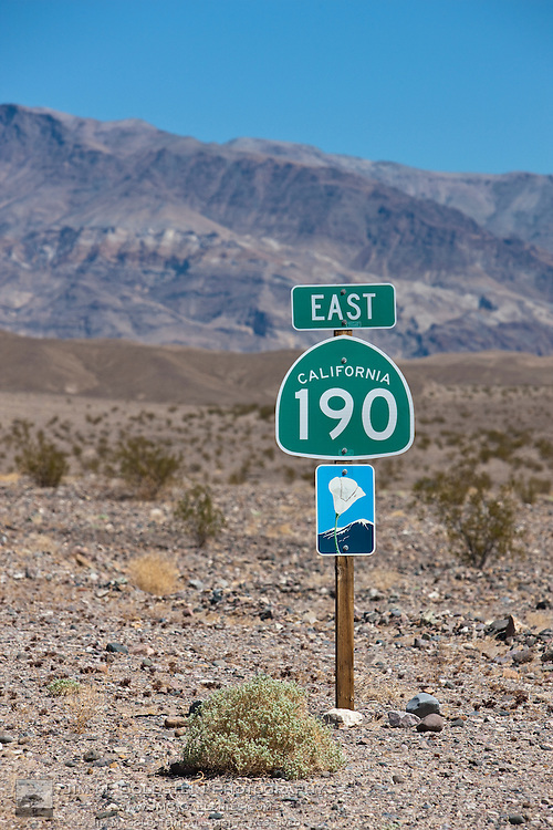 California state route 190 scenic byway sign and desert landscape- Death Valley National Park, California