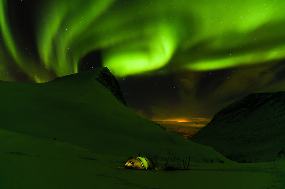 A weekend escape to the mountains pays off extra as the arctic light show begins just before bedtime.