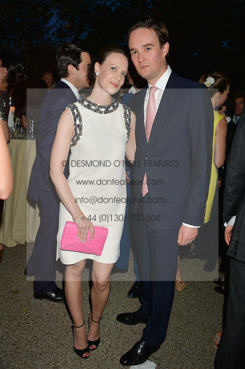 GEORGE & ARABELLA GALLIERS-PRATT at a dinner hosted by Cartier in celebration of The Chelsea Flower Show held at The Hurlingham Club, London on 19th May 2014.