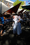 Man dressed as a fairy queen, carrying a ball and chain. The Rocks, Sydney, Australia
