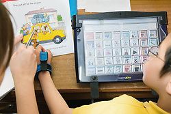 Child with cerebral palsy using an electronic speech aid,