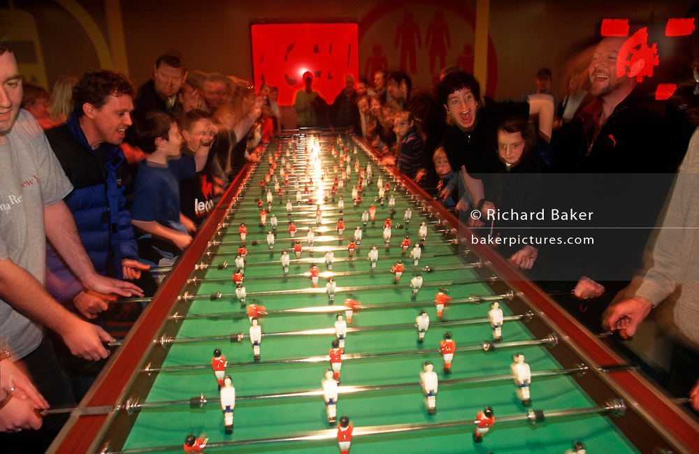 Visitors enjoy a game of giant fussball table inside The Millennium Dome (later to become the 02 Arena) weeks after the Millennium, on 14th January 2000, in London, England. (Photo by Richard Baker / In Pictures via Getty Images)