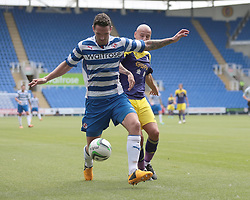 Reading defender Sean Morrison (15) is marshalled out by Swansea City midfielder Jonjo Shelvey (8) during the pre-season friendly game between Reading and Swansea City.  Photo mandatory by-line: Nigel Pitts-Drake/JMP  - Tel: Mobile:07966 386802 27/07/2013 - Reading v  Swansea City  - SPORT - FOOTBALL - pre-season - Reading - Madejski Stadium