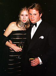 MISS MARISSA SACKLER daughter of Dr Mortimer Sackler and MR GEORGE BAMFORD son of Sir Anthony Bamford, at a party in Oxfordshire on 11th September 1999.MWE 52
