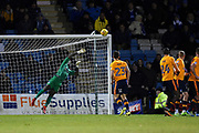 Oldham Athletic goalkeper Johny Placide (19) about to tip the ball onto the bar during the EFL Sky Bet League 1 match between Gillingham and Oldham Athletic at the MEMS Priestfield Stadium, Gillingham, England on 25 November 2017. Photo by Martin Cole.