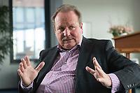 26 FEB 2016, BERLIN/GERMANY:<br /> Frank Bsirske, Vorsitzender der Vereinten Dienstleistungsgewerkschaft, ver.di, während einem Interview, in seinem Buero, ver.di Bundesverwaltung<br /> IMAGE: 20160226-01-025<br /> KEYWORDS: Büro