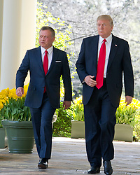 United States President Donald J. Trump, right, and King Abdullah II of Jordan, left walk on the Colonnade prior too conducting a joint press conference in the Rose Garden of the White House in Washington, DC on Wednesday, April 5, 2017.<br /> Credit: Ron Sachs / CNP *** Please Use Credit from Credit Field ***