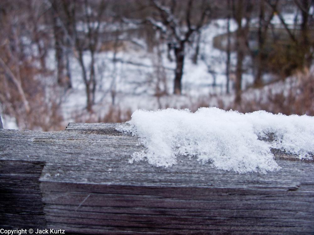 06 DECEMBER 2008 -- MINNETONKA, MN: Snow on a split rail fence along Minnehaha Creek in Minnetonka, MN. PHOTO BY JACK KURTZ