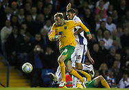 Leeds - Monday October 19th, 2009: Bradley Johnson (16) of Leeds United and Stephen Hughes of Norwich City during the Coca Cola League One match at Elland Road, Leeds. (Pic by Paul Thomas/Focus Images)..