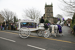 © Licensed to London News Pictures. 18/01/2015. Measham, Leicestershire, UK. The scene outside St Laurence's Church in the centre of Measham for the service of Kayleigh Haywood. Pictured, The funeral procession arrives at the church. Photo credit : Dave Warren/LNP