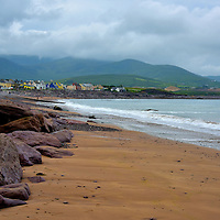Waterville Beach along the Ring of Kerry, Ireland<br /> The traditional Irish name for this coastal village is An Coire&aacute;n meaning cooking pot. Waterville is on a sliver of land bordered between Lough Currane and this beach on Ballinskelligs Bay. There is not much to see in this town of less than 500 people. But nearby are historic sites such as the Waterville House (18th century Gregorian mansion), the Hog&rsquo;s Head Signal Station (built in 1806) plus the ruins of Ballinskelligs Abbey (circa 1210) and the MacCarthy M&oacute;r Castle (16th century). Nature lovers enjoy the abundance of marine life (animals, crustaceans and fish), over twenty bird species and an abundance of flora.