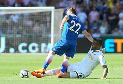 Jordan Ayew of Swansea City tackles Xherdan Shaqiri of Stoke City-Mandatory by-line: Nizaam Jones/JMP- 13/05/2018 - FOOTBALL - Liberty Stadium - Swansea, Wales - Swansea City v Stoke City - Premier League