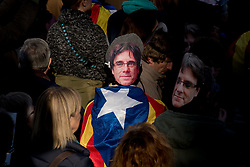 January 30, 2018 - Barcelon, Catalonia, Spain - A man  wearing a mask of deposed president Carles Puigdemont and wrapped with a estelada or pro-independence flag  holds a protest in Barcelona. Thousands of people protested by the streets of Barcelona and outside the Parliament of Catalonia after the session scheduled  to elect a new Catalan president was postponed. (Credit Image: © Jordi Boixareu via ZUMA Wire)