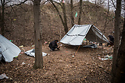 Migrants from Pakistan are seen building a tent with some plastic sheets donated by some volunters, hundreds are living in the wood next to Subotica city center trying to cross the Hungarian border about 10 Km away. Subotica, Serbia, March 18th, 2017. Federico Scoppa/CAPTA
