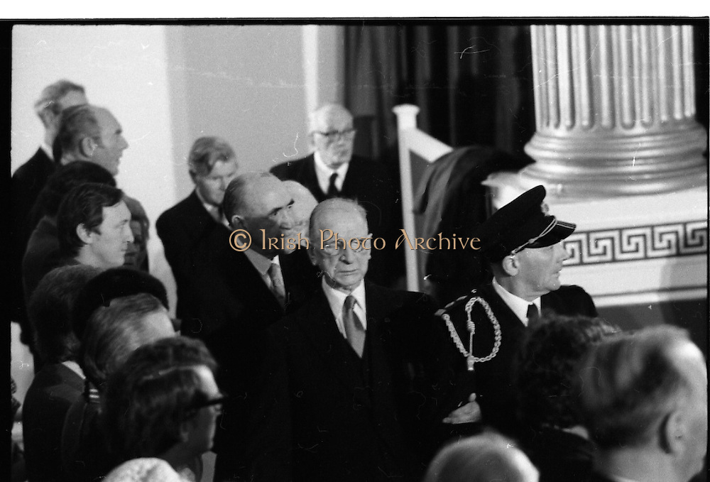 Inaugeration of Cearbhall O'Dalaigh as President  (H77).1974..19.12.1974..12.19.1974..19th December 1974..Following the sudden death of President Erskine Childers, Mr Cearbhall O'Dalaigh was nominated by The Fianna Fail party as its candidate to replace him. The Fine Gael /Labour coalition government did not oppose the nomination and Mr O'Dalaigh was elected un-opposed on a joint party agreement...Picture of a rather frail ex-President DeValera being escorted from the stage by his aide-de-camp.