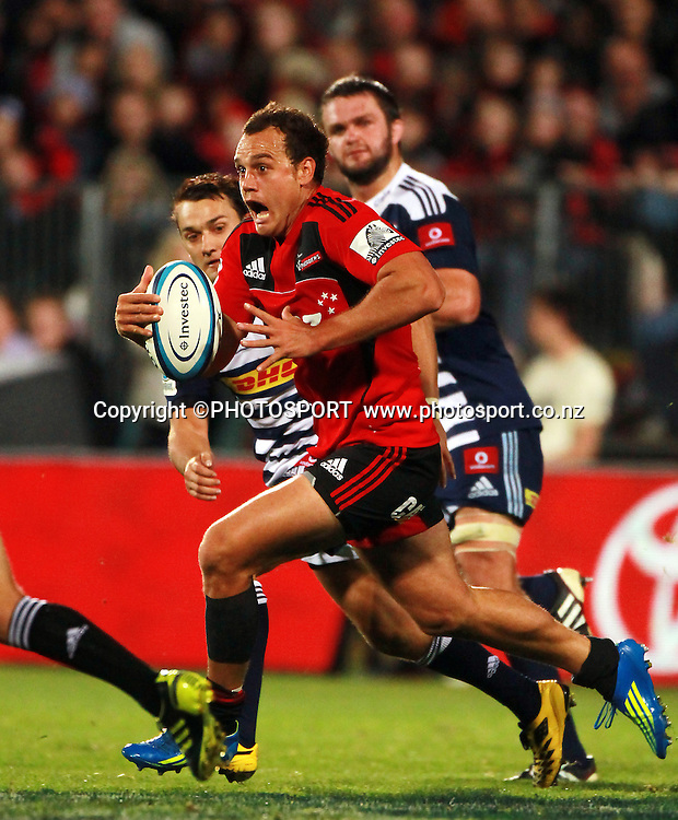 Israel Dagg runs with the ball for the Crusaders. Super Rugby game between the Crusaders and the Stormers. Crusaders new Christchurch Stadium at Rugby League Park, Saturday 14 April 2012. Photo : Joseph Johnson / photosport.co.nz
