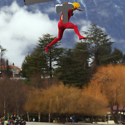 A competitor takes the plunge during the Birdman competition during the 'Day on the Bay' events as part of the Queenstown Winter Festival at the Queenstown, South Island, New Zealand, 26th June 2011