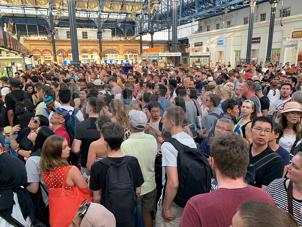 © Licensed to London News Pictures. 29/06/2019. London, UK. Passengers fill the concourse at Brighton railway station as many trains are cancelled as beach goers try to head home after spending the day in record temperatures. Photo credit: Hugo Michiels/LNP