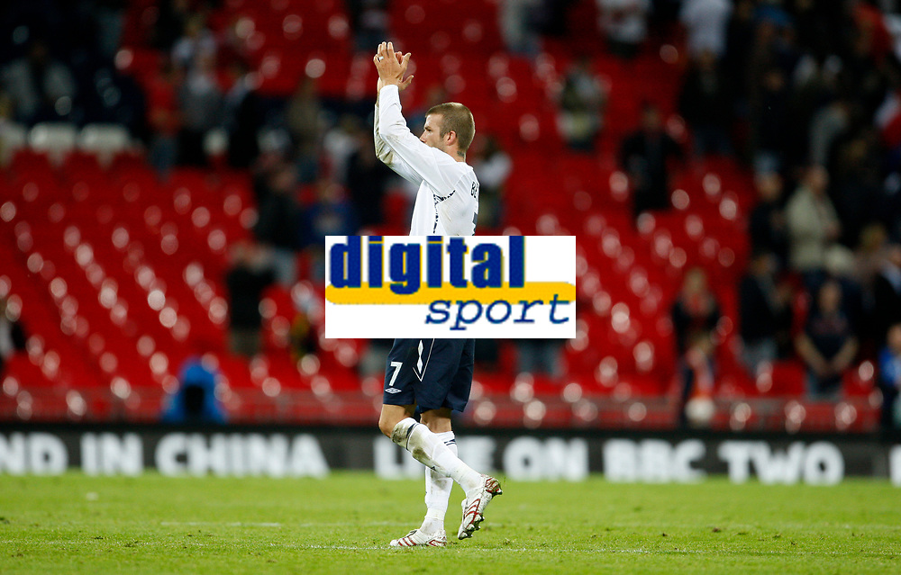 Photo: Richard Lane/Sportsbeat Images.<br />England v Germany. International Friendly. 22/08/2007. <br />England's David Beckham applauds the fans in a half empty stadium as many supporters left before the end of the game.