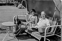 Brian Faulkner with wife Lucy relaxing in their garden after announcing his retirement from politics. 18th August 1976. 197608180625<br />