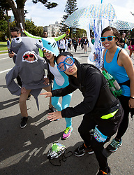 Runners, walkers and the occasional undersea creatures traverse the 7.46-mile course from San Francisco Bay to the Pacific Ocean at the 107th running of the Bay to Breakers, Sunday, May 20, 2018, in San Francisco. (Photo by D. Ross Cameron)