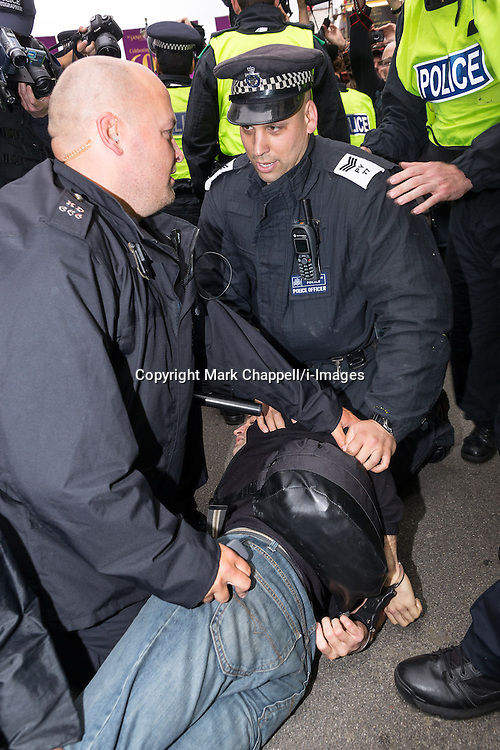 Police detain a protestor on Piccadilly during the J11 protest in central London by the StopG8 anti-capitalist movement.  Tuesday 11  June  2013.  London, UK.<br /> Photo by: Mark Chappell/i-Images