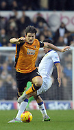 Scott Wootton of Leeds United tackles Harry Maguire of Hull City during the Sky Bet Championship match at Elland Road, Leeds<br /> Picture by Graham Crowther/Focus Images Ltd +44 7763 140036<br /> 05/12/2015