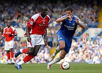 Photo: Ed Godden.<br />Chelsea v Charlton Athletic. The Barclays Premiership. 09/09/2006. Charlton's Amady Faye (L) makes his way past Michael Ballack.