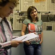 Editor Elena Milashina at the office of  Novaya Gazeta newspaper in Moscow. Novaya Gazeta is one of the few remaining independent media outlets in Russia that dare to challenge the Kremlin, but it has paid a heavy price for its courage. Anna Politkovskaya, the newspaper's most prominent journalist, was gunned down in her apartment block in Moscow in 2006.   ..Picture by Justin Jin.