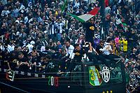 Gianluigi Buffon sventola una bandiera tricolore .Juventus team celebrates winning of italian championship on a bus in Piazza Castello, center of Turin .L'autobus scoperto con la squadra della Juventus Campione d'Italia in Piazza Castello gremita di tifosi .Torino 05/05/2013 Piazza Castello.Football Calcio Serie A  2012/13.Festeggiamenti Juventus Campione d'Italia .Foto Insidefoto Federico Tardito