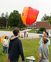 Mr. White and his 8th grader science students take flight with their hot air balloons.  Karen Bobotas/for the Laconia Daily Sun
