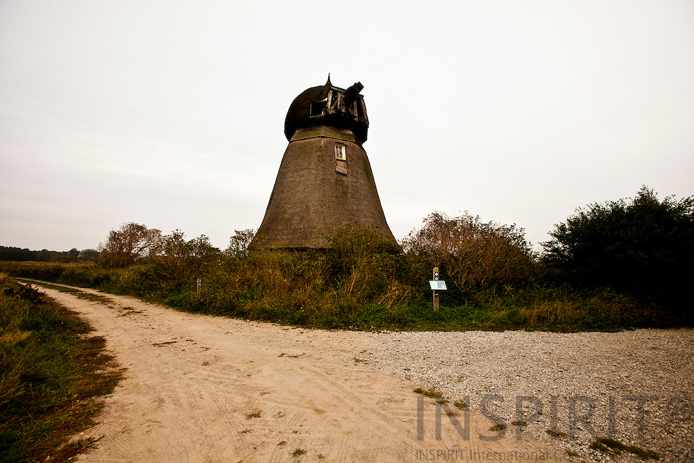 "AEROE, DENMARK - 02 OCTOMBER 2010 -- Den fredede Vitsø mølle er opført i 1838 til at afvande Vitsø fjord. Møllen er den eneste i Danmark, som har bevaret archimediske snegle af træ, der ""skruede"" vandet op. PHOTO: ERIK LUNTANG / INSPIRIT Photo...Vitsoe Cove pump mill is from 1838 and lies between the drainage channels. This type of windmill is called a soil Dutchman"". The mill is one of Denmark's first windmills with a mechanism known as Archimedes' screw: a spiral screw inside a tight-fitting hollow pipe. As the screw turns, the thread lifts water from the bottom and out the top of the pipe. PHOTO: ERIK LUNTANG / INSPIRIT Photo."