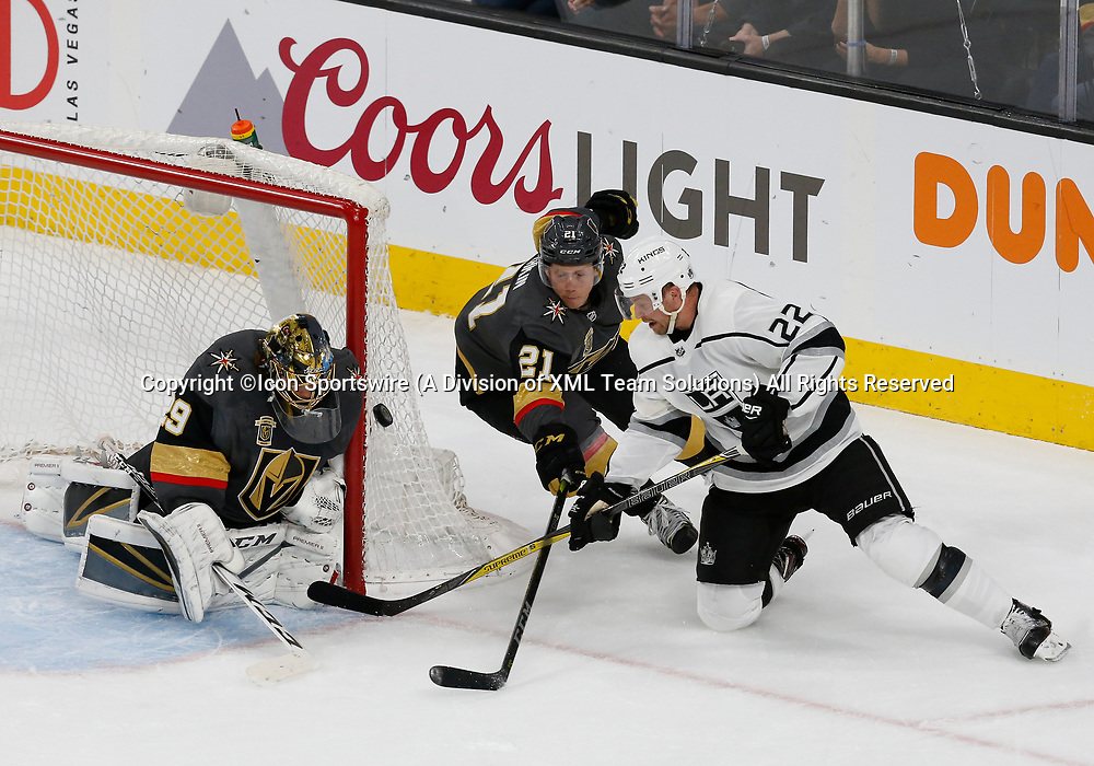 LAS VEGAS, NV - APRIL 11: Los Angeles Kings center Trevor Lewis (22) takes a shot against Vegas Golden Knights goaltender Marc-Andre Fleury (29) as center Cody Eakin (21) defends during Game One of the Western Conference First Round of the 2018 NHL Stanley Cup Playoffs between the L.A. Kings and the Vegas Golden Knights Wednesday, April 11, 2018, at T-Mobile Arena in Las Vegas, Nevada. The Golden Knights won 1-0.  (Photo by: Marc Sanchez/Icon Sportswire)