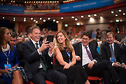 © Licensed to London News Pictures. 29/09/2014. Birmingham, UK. Grant Shapps, Karen Brady and Lord Feldman laugh at a picture of themselves on a tablet computer handed to them by a photographer. The Conservative Party Conference in Birmingham 29th September 2014. Photo credit : Stephen Simpson/LNP