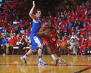 "Ole MIss forward Reginald Buckner (2)  dribbles against Kentucky's Josh Harrellson (55) at the C.M. ""Tad"" Smith Coliseum in Oxford, Miss. on Tuesday, February 1, 2011. Ole Miss won 71-69."