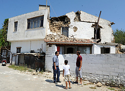 July 21, 2017 - Mugla, Turkey - A damaged house is seen following an earthquake, in the Agean coastal city of Mugla, Datca Province. A strong 6.7 magnitude earthquake hit Turkey's Aegean coast, and at least 90 people were injured as a sea surge caused damages in buildings and streets. Two people were killed and dozens were injured on the Greek Island of Kos and beachfront hotels have been flooded on both Turkish and Greek coasts after the earthquake hit in the Aegean Sea. (Credit Image: © Hikmet Saatci/Depo Photos via ZUMA Wire)