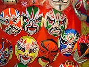 """26 NOVEMBER 2014 - BANGKOK, THAILAND: Chinese opera masks for sale as souvenirs at the Chow Su Kong Shrine in the Talat Noi neighborhood of Bangkok. Chinese opera was once very popular in Thailand, where it is called """"Ngiew."""" It is usually performed in the Teochew language. Millions of Chinese emigrated to Thailand (then Siam) in the 18th and 19th centuries and brought their culture with them. Recently the popularity of ngiew has faded as people turn to performances of opera on DVD or movies. There are about 30 Chinese opera troupes left in Bangkok and its environs. They are especially busy during Chinese New Year and Chinese holidays when they travel from Chinese temple to Chinese temple performing on stages they put up in streets near the temple, sometimes sleeping on hammocks they sling under their stage.      PHOTO BY JACK KURTZ"""