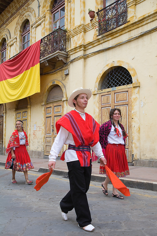 South America, Ecuador, Cuenca.  Dancers in folklore troupe during annual parade and festival to celebrate founding of Cuenca in 1557.  Cuenca is a UNESCO World Heritage Site.