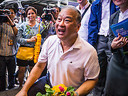 16 JANUARY 2013 - BANGKOK, THAILAND:   SUKHUMBHAND PARIBATRA, candidate for Governor of Bangkok, during a campaign walk in downtown Bangkok Wednesday. The Oxford educated Sukhumbhand is a member of the Thai royal family (he is a great grandson of the late Thai King Chulalongkorn). He is a member of the Thai Democrat party and was first elected Governor of Bangkok in 2009. He is running for reelection this year. Sukhumbhand faces six challengers in the March 3 election. His toughest opponent is expected to be Police General Pongsapat Pongcharoen, who is running under the banner of the Pheu Thai Party, which controls the Prime Minister's office and Parliament.   PHOTO BY JACK KURTZ