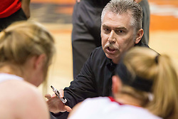 Sissonville head coach Rich Skeen talks to his team during a timeout against Clay County during a first round game at the Charleston Civic Center.