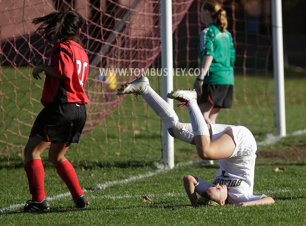 Beacon, New York - A Beacon High School player tumbles on the ground after falling during a Section One Class A girls' soccer playoff game against Sleepy Hollow High School on Oct. 28, 2010. ©Tom Bushey / The Image Works