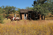 Kentucky Camp, a ghost town in the Coronado National Forest, once served miners near Sonoita, Arizona, USA.  Riders from Arizona Horse Experience ride on horseback through camp.