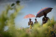 Refugees from one of the refugge camps outside Kabo, on their way to the cemetary, to bury a young woman who died while giving birth to a babyboy.The central African rep. has some of the world's worst child welfare indicators. The infant mortality rate is 112, and out of 1,000 children born in CAR, 171 will die before reaching the age of five. The five main child killers in CAR are malaria, diarrhoea, acute respiratory infections, malnutrition and measles – all preventable diseases. The Accelerated Child Survival and Development Strategy UNICEF is implementing aims to reach every newborn and child in every district with a set of priority interventions. Evidence shows that there are a number of known and affordable interventions that if implemented fully could prevent 63 per cent of current childhood mortality.