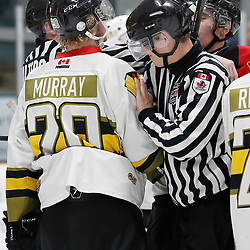 TRENTON, ON  - MAY 5,  2017: Canadian Junior Hockey League, Central Canadian Jr. &quot;A&quot; Championship. The Dudley Hewitt Cup. Game 7 between The Georgetown Raiders and The Powassan Voodoos. OHA Linesman breaks up an altercation during the third period <br /> (Photo by Amy Deroche / OJHL Images)