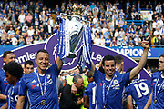 Chelsea Defender John Terry (26) and Chelsea Defender Cesar Azpilicueta (28) celebrates with the trophy during the Premier League match between Chelsea and Sunderland at Stamford Bridge, London, England on 21 May 2017. Photo by Andy Walter.