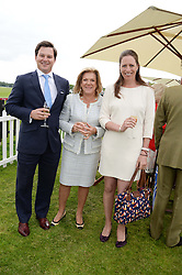 Left to right, GEORGE FOX, ROS PACKER and TAMARA FOX at the 2013 Cartier Queens Cup Polo at Guards Polo Club, Berkshire on 16th June 2013.
