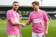 Forest Green Rovers Carl Winchester(7) and Cheltenham Town's Jonny Mullins sport the pink t-shirts supporting charity Colbalt during the EFL Sky Bet League 2 match between Forest Green Rovers and Cheltenham Town at the New Lawn, Forest Green, United Kingdom on 20 October 2018.